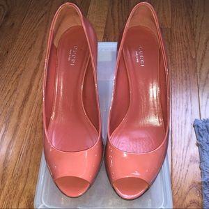 Gucci patent leather open toe pumps.